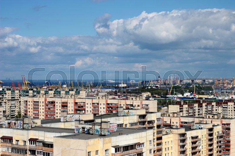 Stock image of 'blue sky over the city from the blue sea'