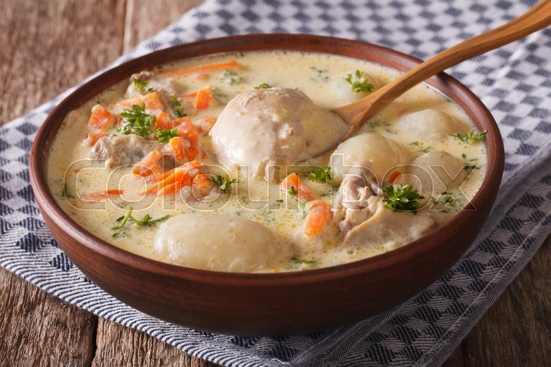 Stock image of 'Creamy soup with chicken and vegetables close up in a bowl on the table. horizontal\'