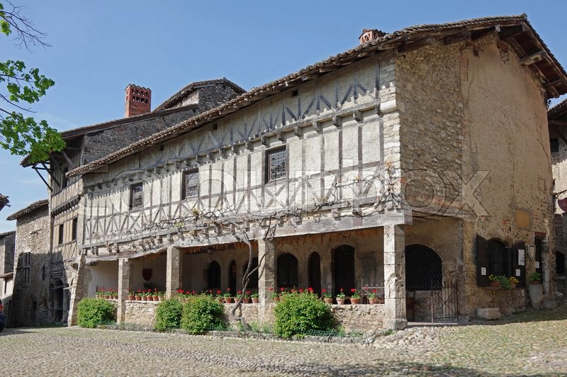 Stock image of 'PEROUGES, FRANCE - 29 APRIL, 2015: Old framework houses at main square of medieval village Perouges in France'
