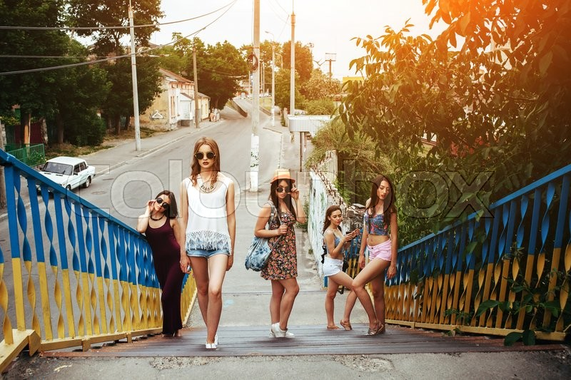 Stock image of 'Five young beautiful girls walking and having fun in the city'