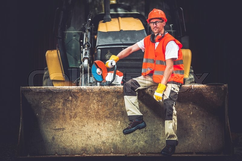Stock image of 'Bulldozer Works Concept. Young Caucasian Men Seating and Relaxing on Bulldozer Blade. Happy Construction Worker. Ground Works.'