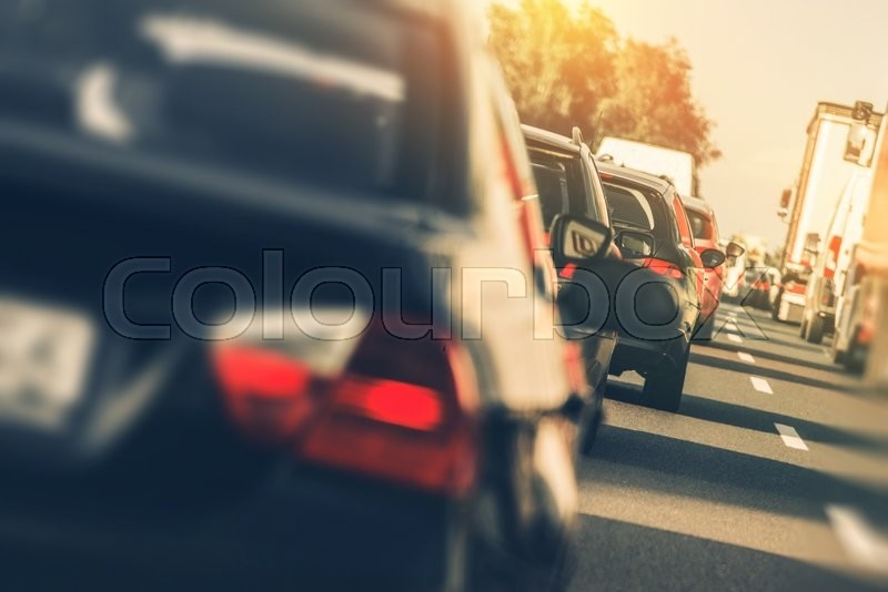 Stock image of 'Heavy Two Lanes Highway Traffic. People Driving Back From Holidays. Vacation Time Traffic.'