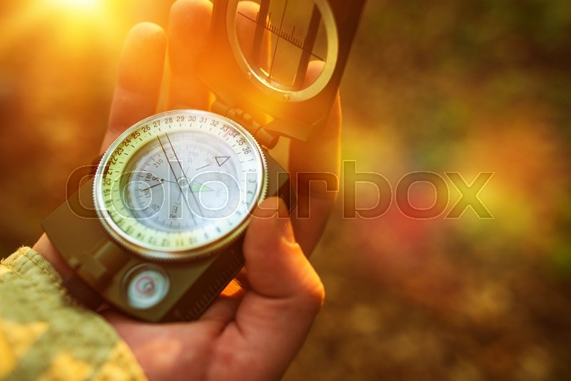Stock image of 'Hiking with Small Compass Device. Compass in a Hand.'