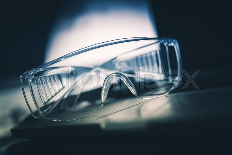 Stock image of 'Laboratory Safety Plastic Glasses Closeup. Laboratory Equipment'