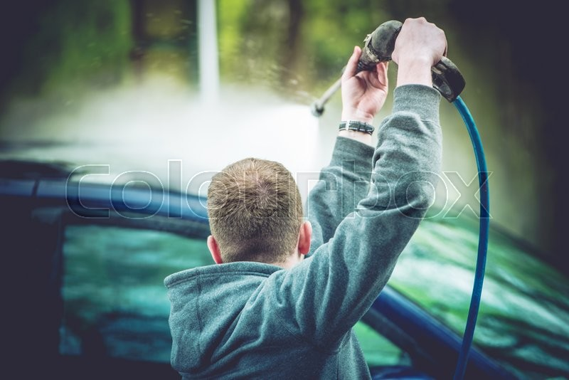 Stock image of 'Manual Car Washing. Vehicle Roof Wash by High Pressured Water. '