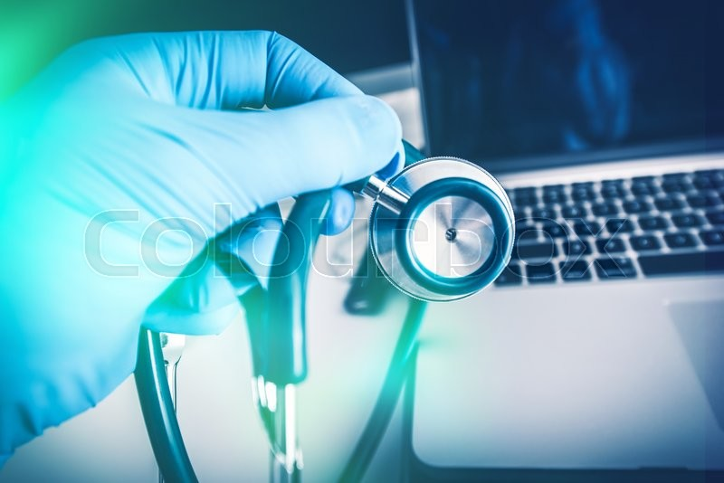 Stock image of 'Physician Stethoscope and His Laptop Computer. Medical Clinic Room Equipment.'