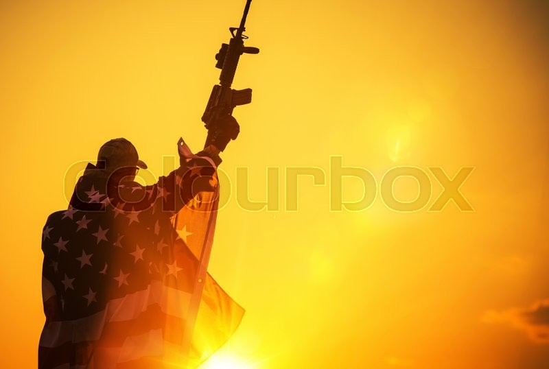 Stock image of 'The American Victory. Army Troop with Assault Rifle Covered by American Flag. American Patriot'