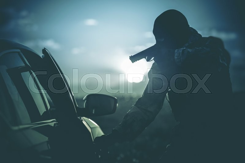 Vehicles Check Point Made by Police. Policeman in a Mask Points Gun at Suspicious Car Passenger. Anti Terrorism Check Point. Military Check Point, stock photo