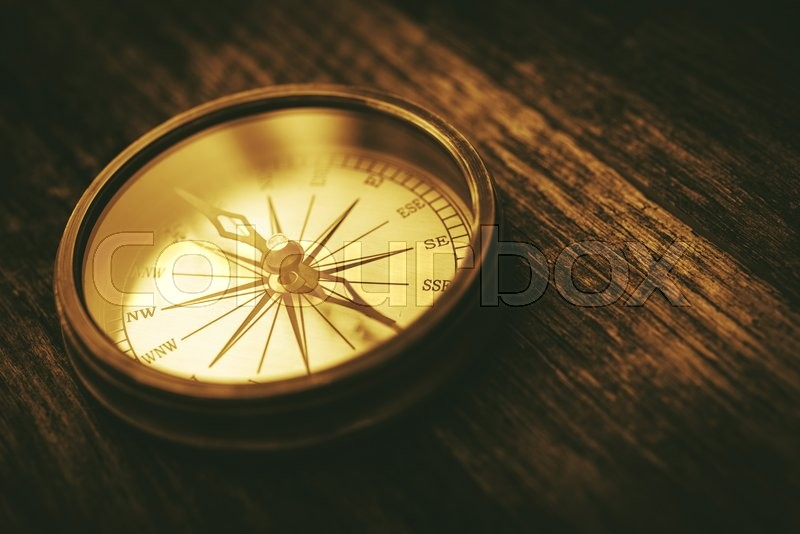 Stock image of 'Vintage Navigation Technology. Old Metallic Compass Device on Aged Wood Boards.'