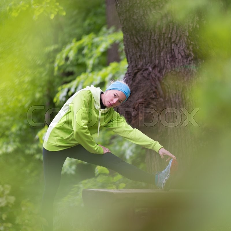 Stock image of 'Sporty young female working out in forest.  Female runner during outdoor workout in nature. Fitness model outdoors. Weight Loss. Healthy lifestyle. '