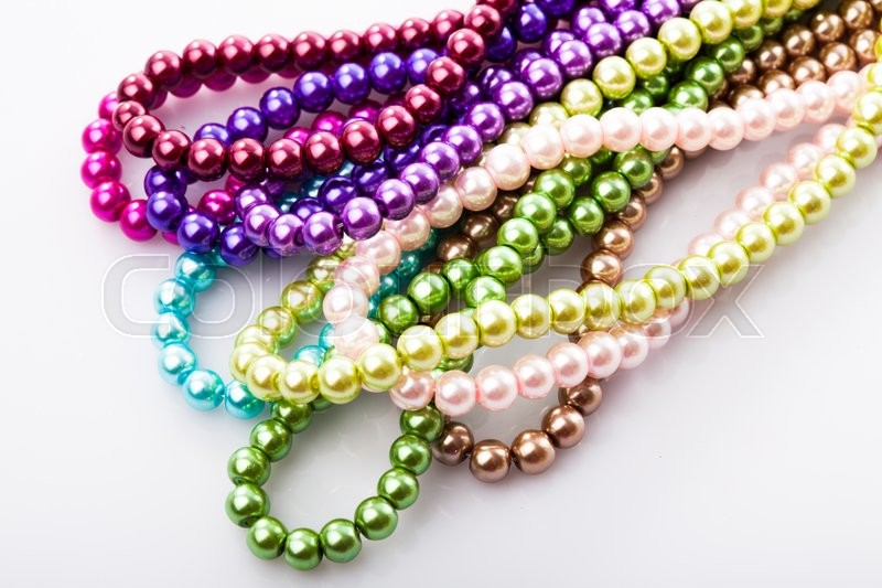 Stock image of 'Different colors of beads necklace closeup background'