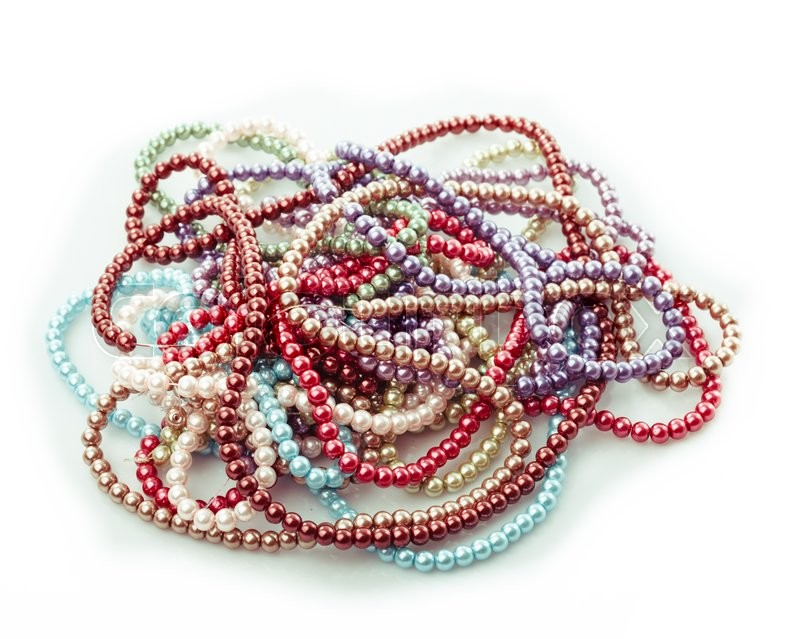 Stock image of 'Different colors of beads necklace isolated on white'