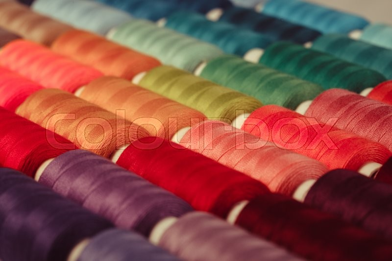 Stock image of 'The sewing threads multicolored background close up'