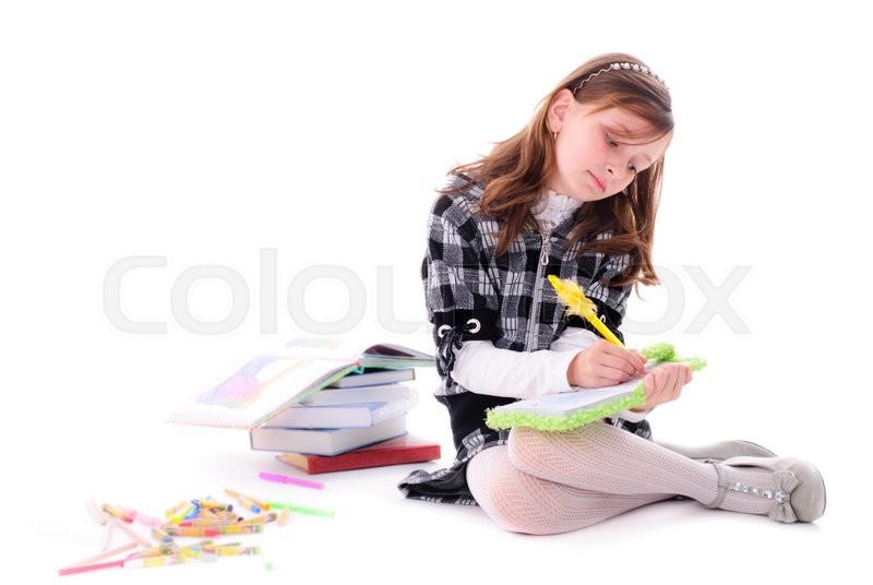 Stock image of 'Girl on the floor is dreaming and writing in the diary'