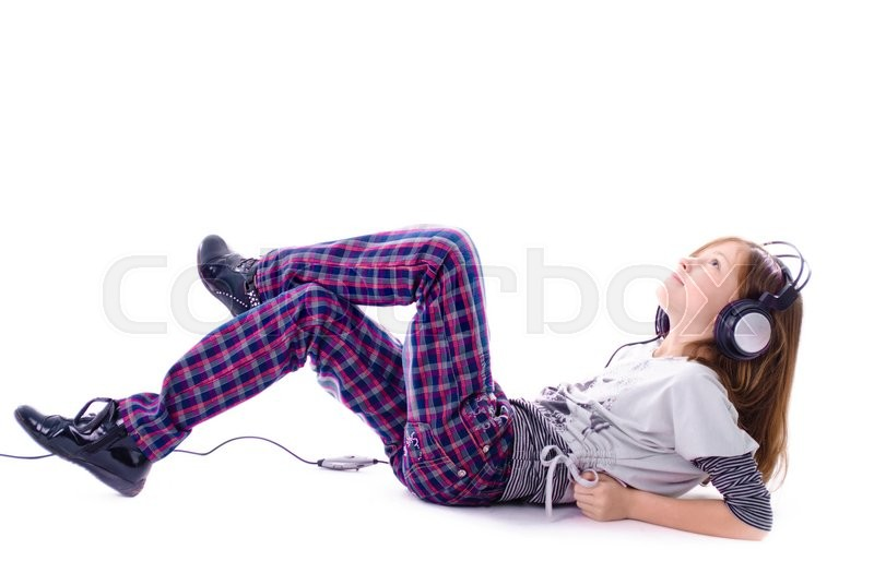 Stock image of 'Girl in headphones is listening the music, isolated on white'