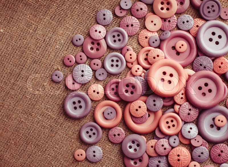 Stock image of 'The collection with many buttons of different colors, shape and sizes on canvas with copy space. Top view'