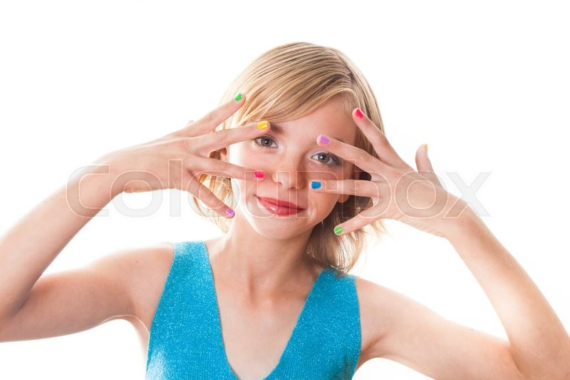 Stock image of 'Teenager blonde girl's face with multicoloured nails close up'