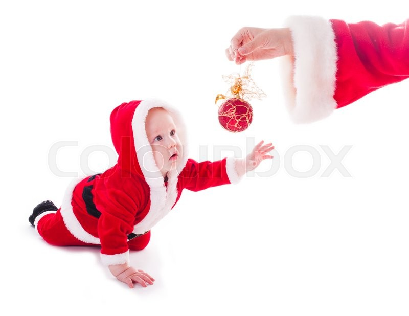 Stock image of 'Little Santa boy wants to play isolated on white background'