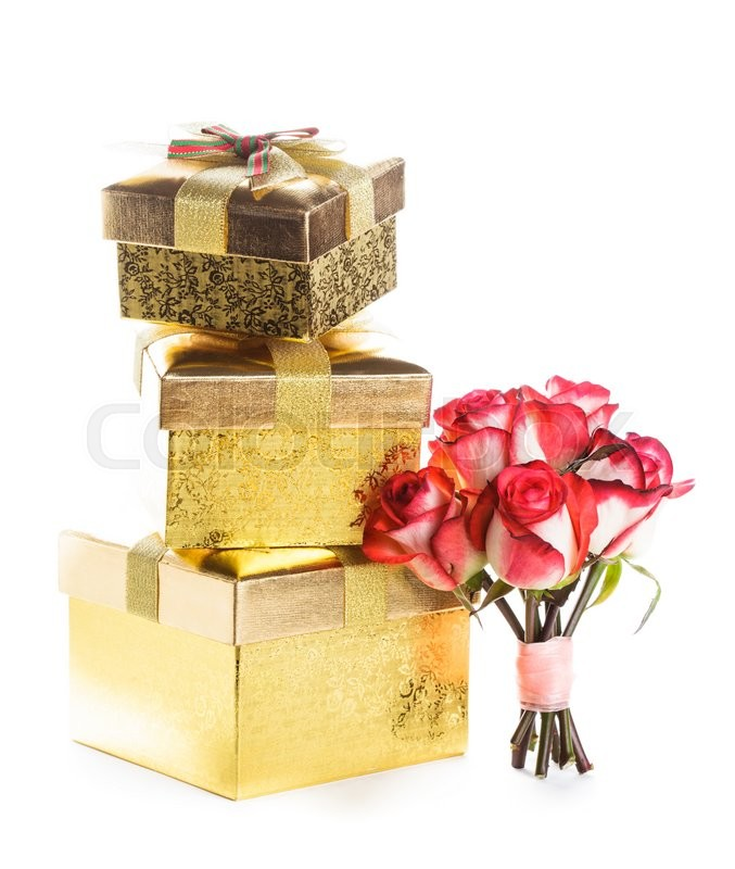 Stock image of 'Golden gift box and bouquet of roses isolated on white'