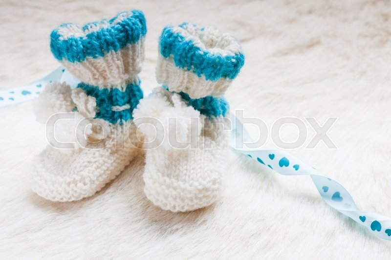 Stock image of 'Knitted blue baby booties for little boy'