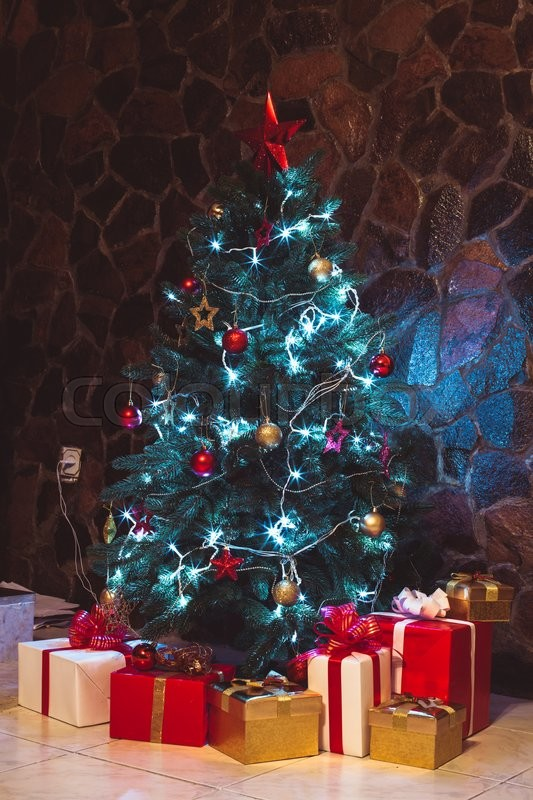 Stock image of 'Presents boxes under the Christmas tree. Gold, red and white colours'