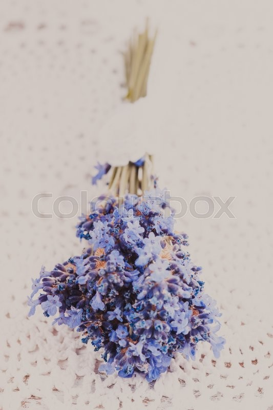 Stock image of 'Fresh lavender bunch, decor provance style on a crochet tablecloth, shabby chic'
