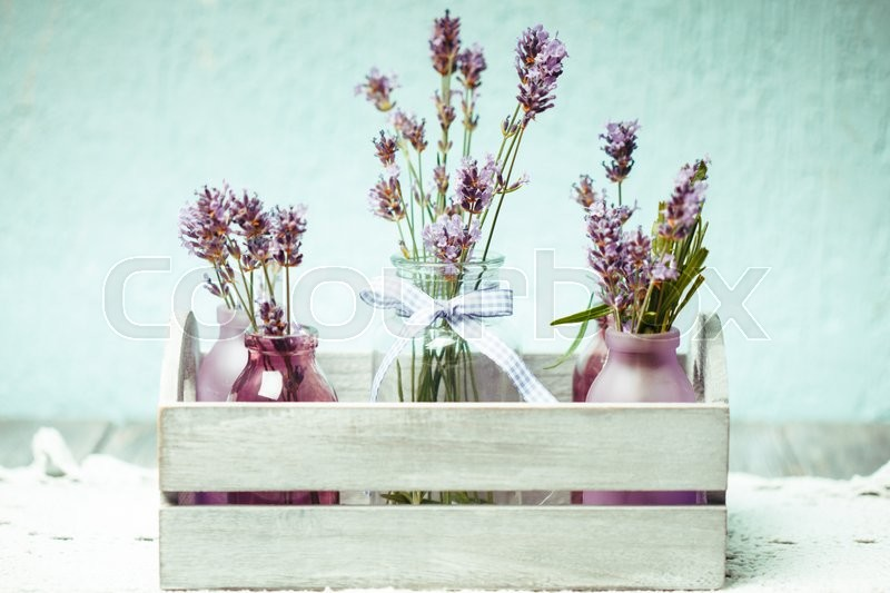 Stock image of 'Lavender in bottles, decor provance style, wooden box on crochet tablecloth'