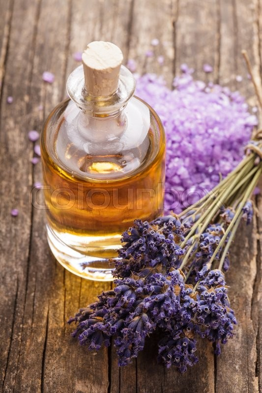 Stock image of 'essential oil with lavender flower and seasalt - spa concept'