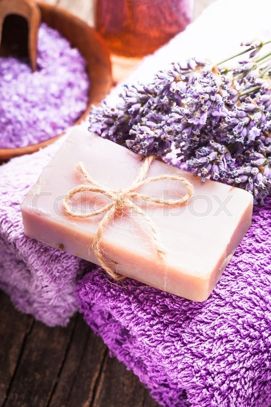 Stock image of 'Lavender spa - essential oil, seasalt, violet towels and handmade soap'