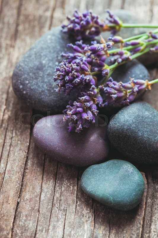 Stock image of 'Stones with lavender on old shabby wooden background'