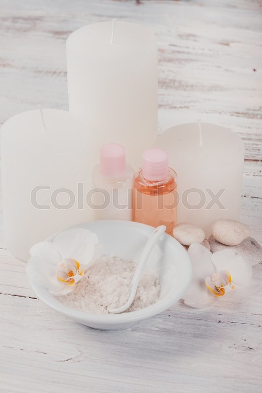 Stock image of 'White orchid spa - sea salt, cream and candles'