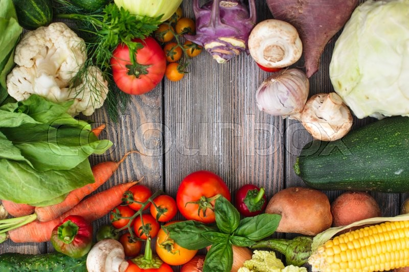 Stock image of 'Various vegetables on a wooden table with copy space'