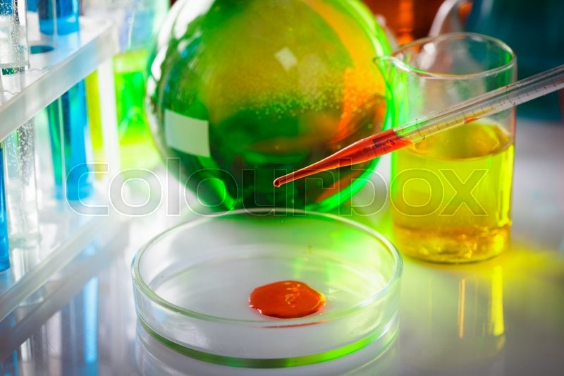 Stock image of 'The blood from pipette in petri dish at the laboratory table'