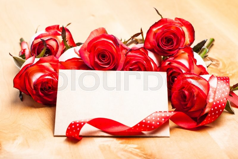 Stock image of 'Craft card with red roses and ribbon for greetings'