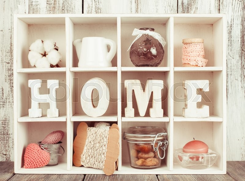 Stock image of 'Shadow box with wooden letters home and cozy things'