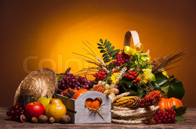 Stock image of 'Happy Thanksgiving still life. Fruits, nuts and vegetables, fall crop on  the table'