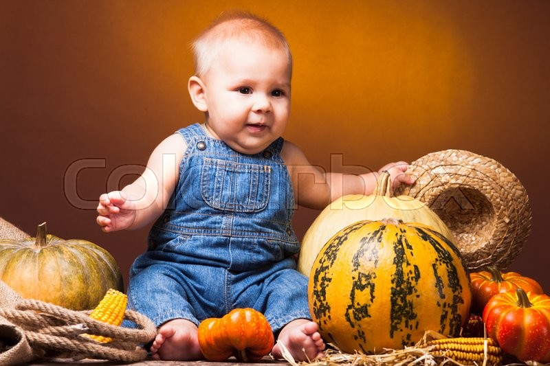 Cute baby posing on the background of pumpkins thanksgiving cute baby posing on the background of pumpkins thanksgiving greetings stock photo colourbox m4hsunfo