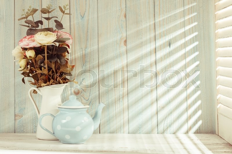 Stock image of 'Morning still life on shabby chic table and light from the blinds'