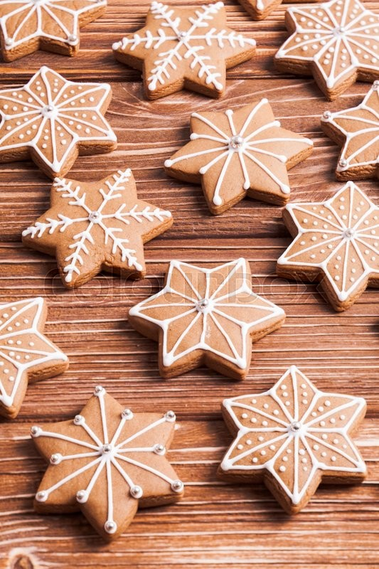 Stock image of 'Gingerbread star cookies on a wooden background.'