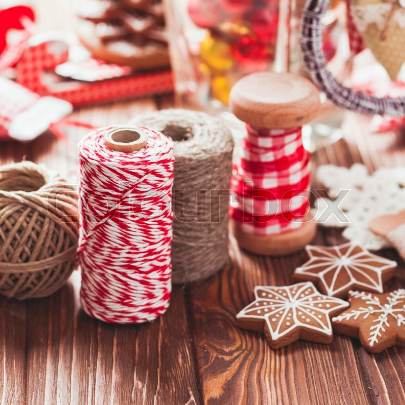 Stock image of 'Christmas gift decorations - red and rustic ropes and gingerbread'