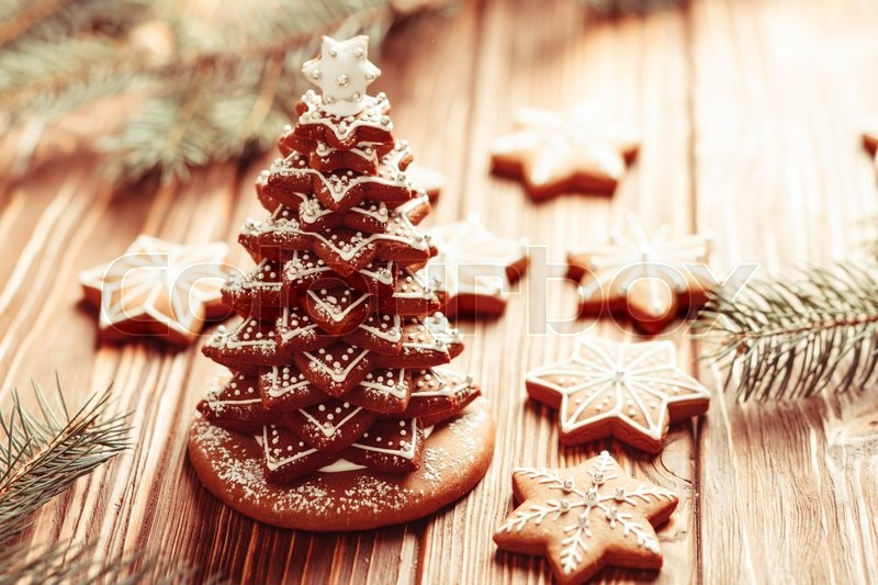 Stock image of 'Gingerbread cookies. Christmas tree from cookies with icing on the table'