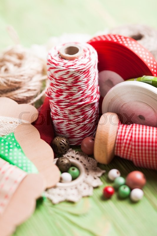 Stock image of 'Holiday rope and ribbon decorations for craft paper gift box'