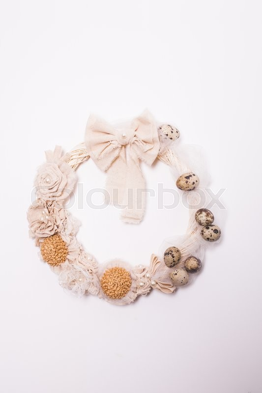 Stock image of 'Easter wreath with white bow on the front door isolated on white'