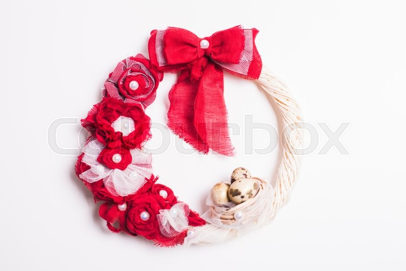 Stock image of 'Easter wreath with red bow on the front door'