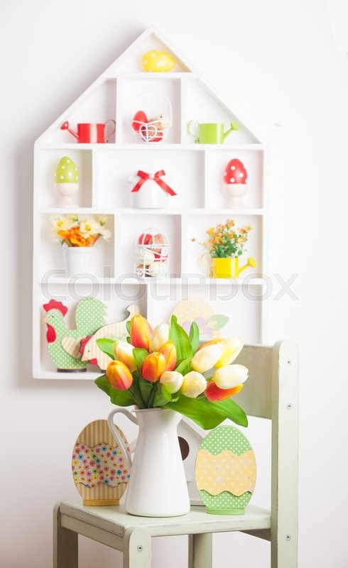 Stock image of 'House shelves on a wall - Easter decorations for holiday'