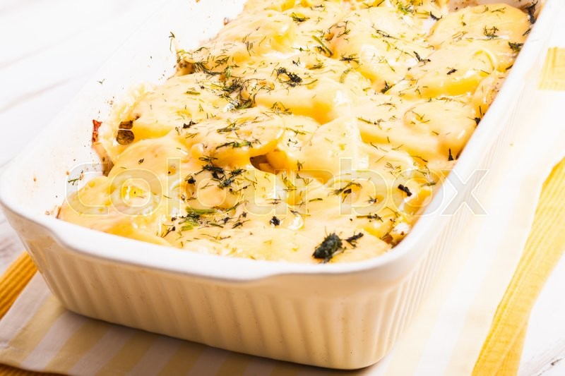 Stock image of 'The potato casserole - baked with cheese and herbs'