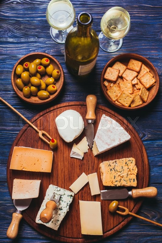 Stock image of 'Pair have a nice evening with cheese plate and wine'