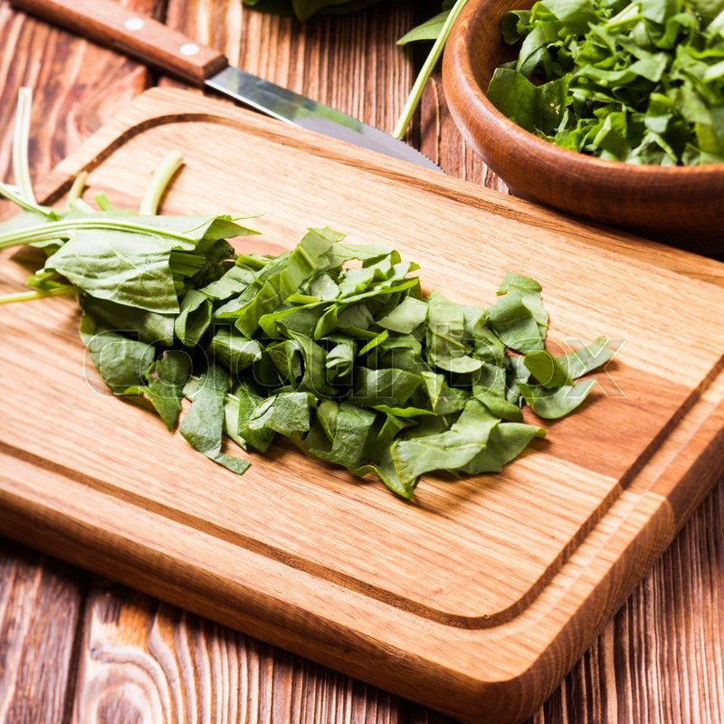 Stock image of 'Fresh green sorrel on a wooden board'
