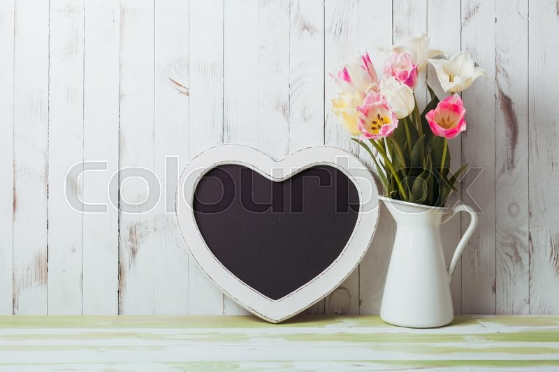 Stock image of 'Kitchen table top in rustic shabby chic style, heart shape chalkboard'