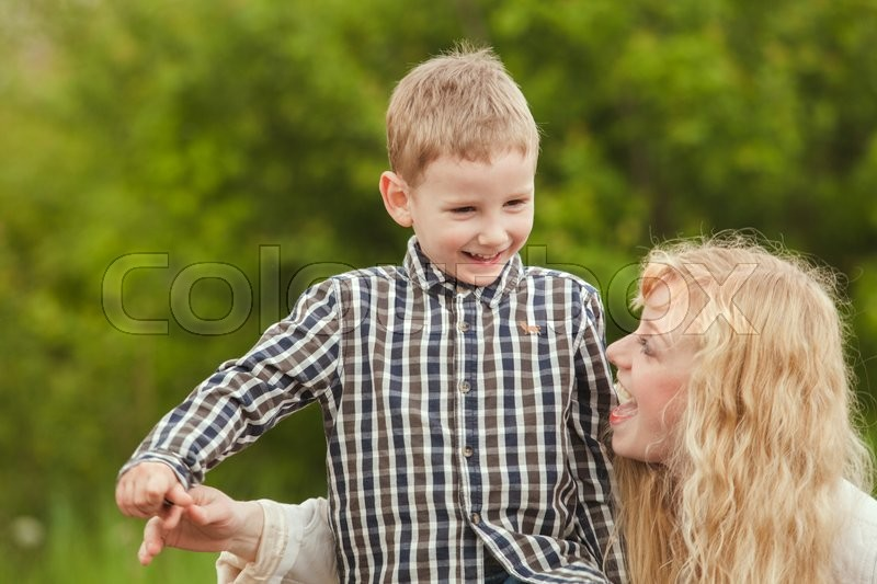 Stock image of 'Portrait of a happy mother hugging her son'